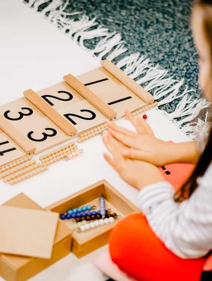 children's house student with montessori math work