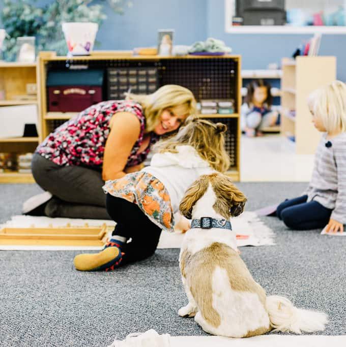 montessori teacher giving a lesson to a preschool kindergarten child