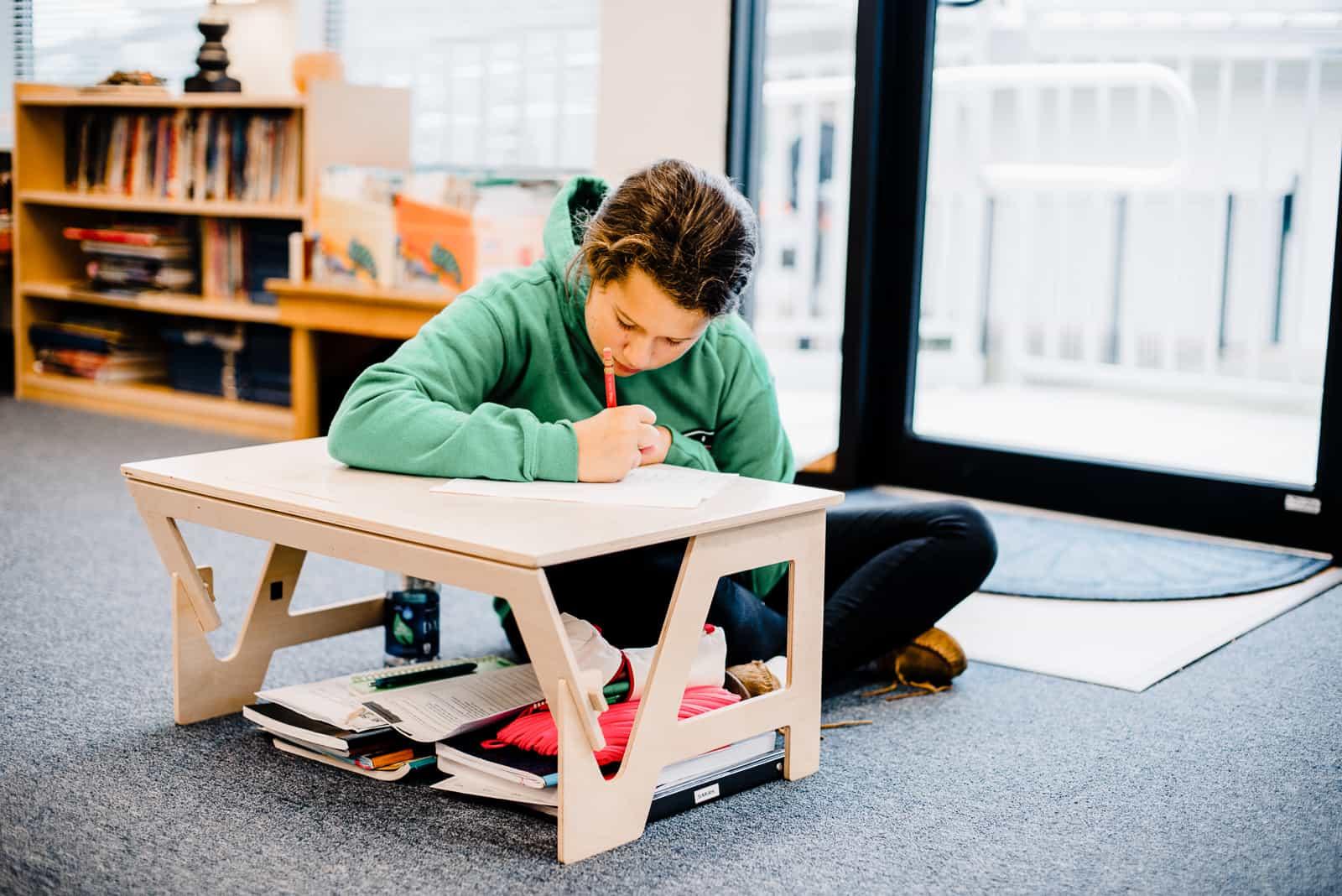 upper elementary student working independently montessori